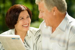 Man and woman reading paper together | Dentist Saint Paul MN