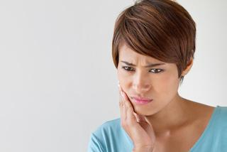 Woman with bad tooth pain in St Paul, MN