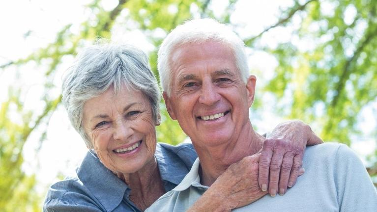 Older couple smiling outside | Root Canals St Paul MN