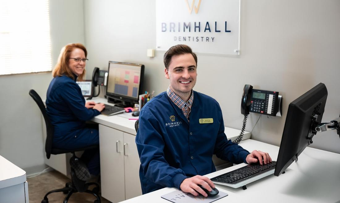 Employees at front desk of Brimhall Dentistry in St Paul MN